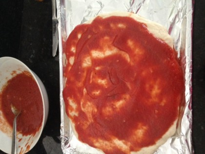 I spread the tomato sauce on the dough. I chose one that had only 10 mg of sodium in it!